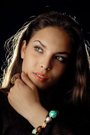Studio portrait of the pretty woman with jewelry Stock Photo - 2683698