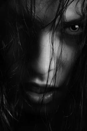scary face: BW portrait of the angry witch-woman with wet hairs
