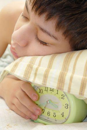 recreate: Deep sleeping boy and alarm-clock
