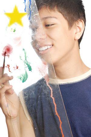 Stuio photo of the boy drawing by paintbrush photo