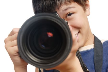 Photo of  smiling boy with digital camera and big lens photo