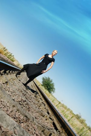 nicety: Self-confident model posing on the railway
