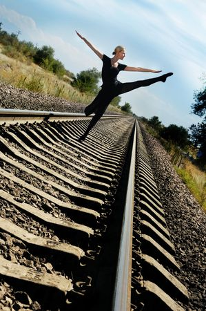 plasticity: Woman dances on railway and does not fear the train