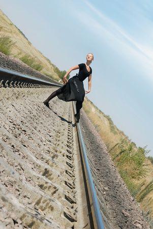 Ballet dancer posing on the railway photo