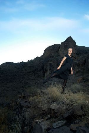Photo of the ballet dancer and sunset at the background photo