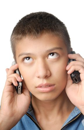 Boy with two cell phones on a white background photo