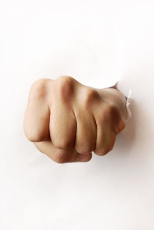 knockdown: Photo of the hitting fist damaged the paper board Stock Photo