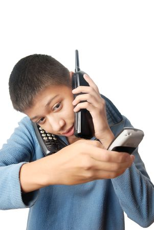 Boy having an urgent talk via three telephones photo