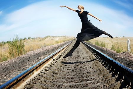 Wide-angle photo of the ballet dancer jumping photo