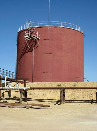 condensate: Photo of oil tank at industrial site with nice blue sky Stock Photo