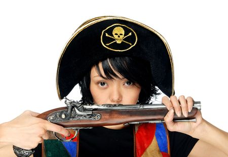 Woman in pirate costume with ancient pistol in hands photo