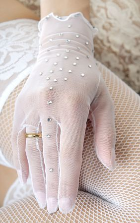Close-up photo of the elegant hand in glove with wedding ring Stock Photo - 2947454