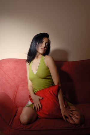 Temptation of the pretty lady embracing red pillow Stock Photo - 2951749