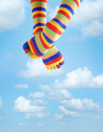 hosiery: Photo of the legs in zebrine socks sitting in the sky