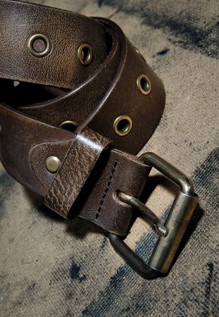 firmness: Close-up photo of the leather belt on textured background Stock Photo