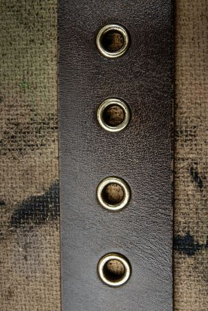 trashy: Close-up photo of the leather belt on a dirty background
