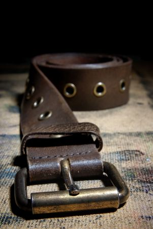 rigidity: Close-up photo of the leather belt on the dirty surface