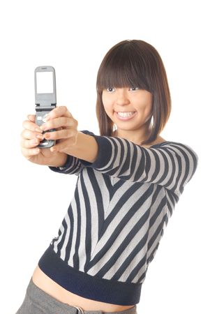 glad: Photo of the glad teenager make a photo using cellular phone