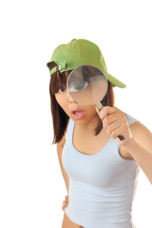 pry: Clever girl with magnifier trying to make investigation Stock Photo