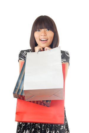 Photo of the glad lady with three shopping packages photo