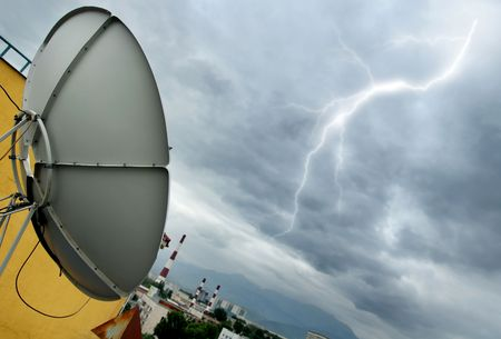 Creative photo of the high-tech parabolic antenna and lightning photo