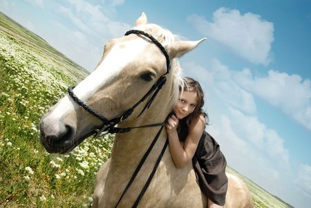 Portrait of the smiling woman and horse outdoors photo