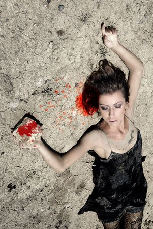 killings: Lady laying on a desert ground and killing herself by the stone