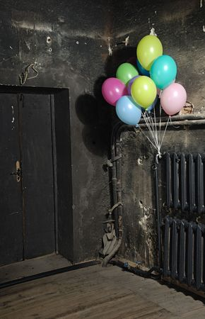trashy: Celebrating colorful balloons in trashy dark interrior for Halloween