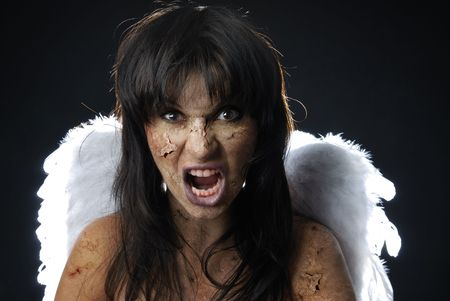 fiend: Devil with angelic wings and blood in mouth Stock Photo