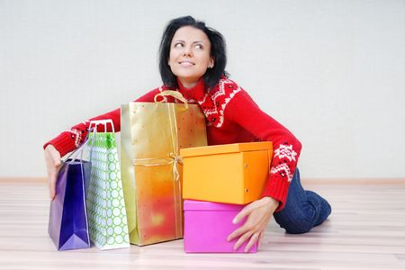 glad: Glad lady indoors with gift shopping presents