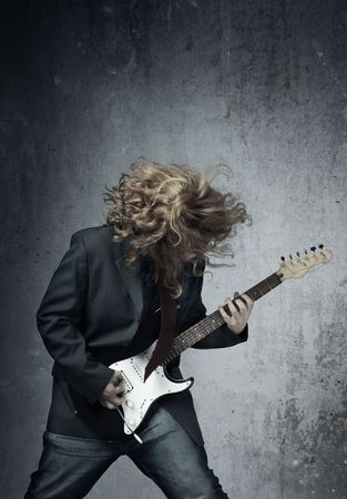 harmonist: Electric guitar player on a trash background playing the rock music