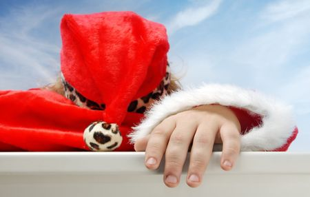 Close-up portrait of sleeping Santa Claus outdoors photo