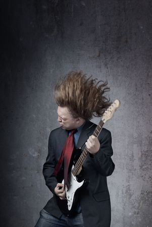 harmonist: Emotional photo of the man playin on electric guitar Stock Photo