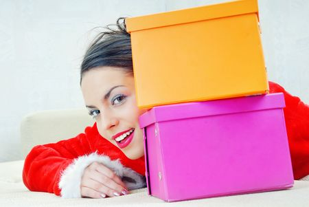 Smiling lady behind the boxes with bought gifts photo