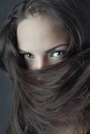 Close-up portrait of the woman face covered by her hairs Stock Photo - 4033625