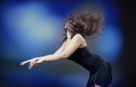 Elegant lady dancing in front of disko light photo