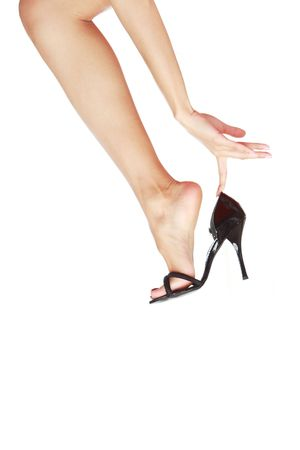 Elegant woman leg in the black shoe on a white background Stock Photo - 4149751