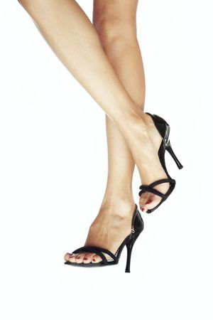Two woman legs in the black shoes with heel Stock Photo - 4191549