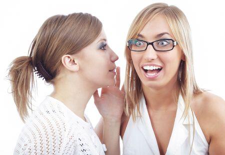 two friends talking: Two friends talking something secret Stock Photo