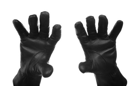 delinquent: Hands of the criminal person in black leather gloves