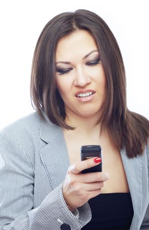 dullness: Businesswoman reading boring SMS on her cell phone Stock Photo