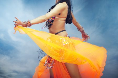 Lady dancing belly dance outdoors in summer photo