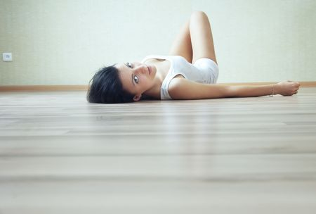 recreate: Lady at home in domestic clothes laying on the floor