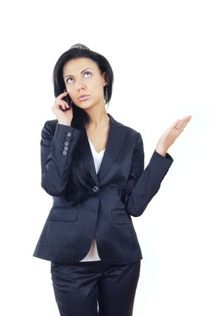 Businesswoman talking via cell phone on a white background Stock Photo - 4505881