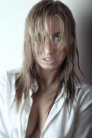 Pretty woman with big and wet hair in open shirt Stock Photo - 4505880