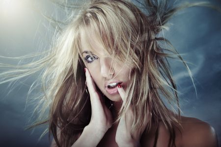 Lady outdoors with long hairs blown by the cooling wind Stock Photo