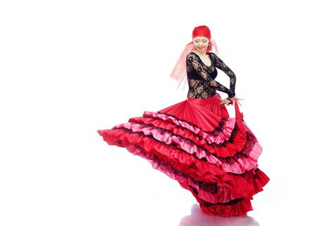 expressional: Smiling lady dancing Flamenco in traditional costume
