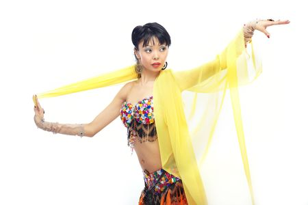 bellydance: Asian lady dancing belly-dance with yellow fabric