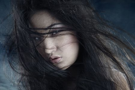 Asian lady outdoors with long blowing hairs photo