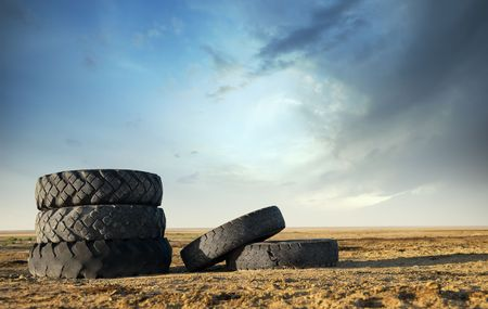 Five abandoned tires outdoors as a symbol of environmental pollution photo